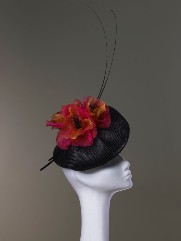 Black parasisal straw hat with organza poppies and quills