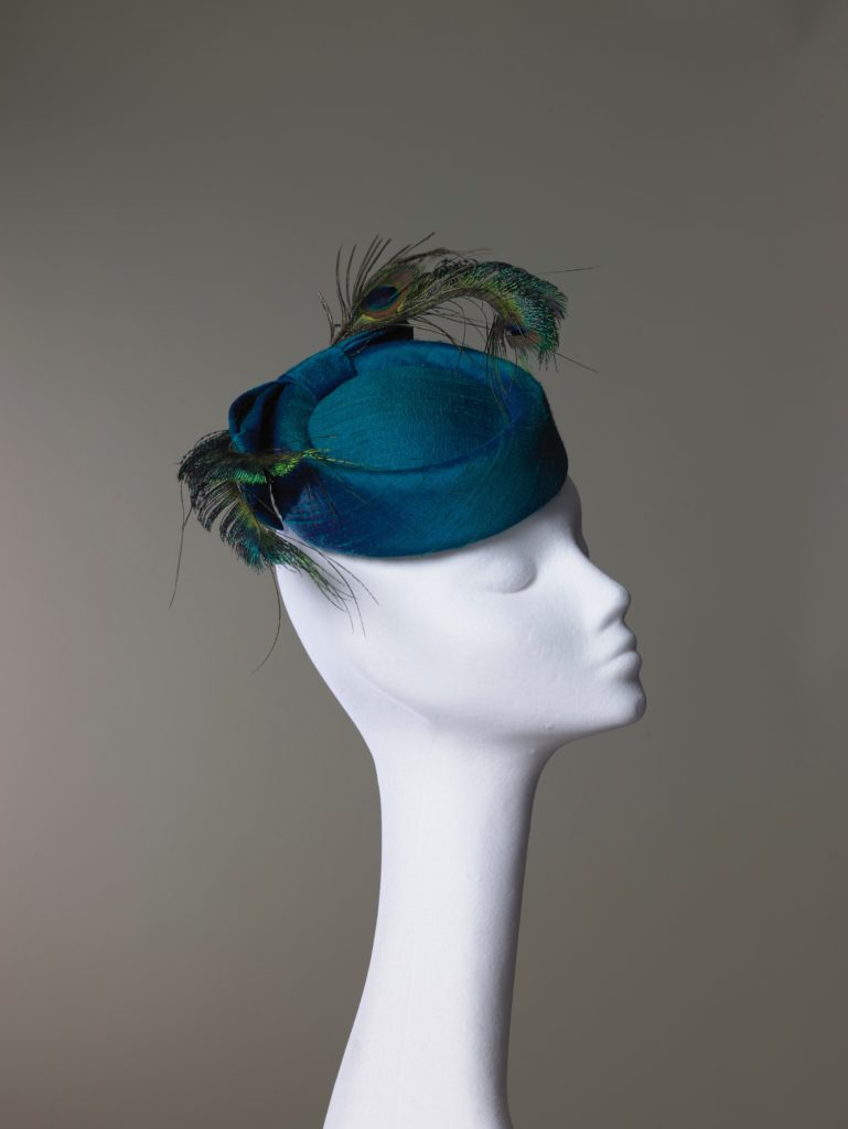 Teal silk pillbox hat with peacock feathers
