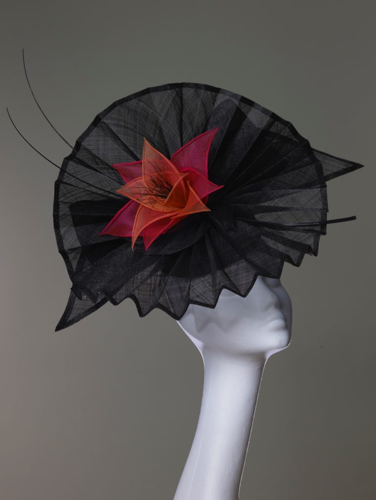 Black pleated pinok pok headpiece with organza flowers and quills
