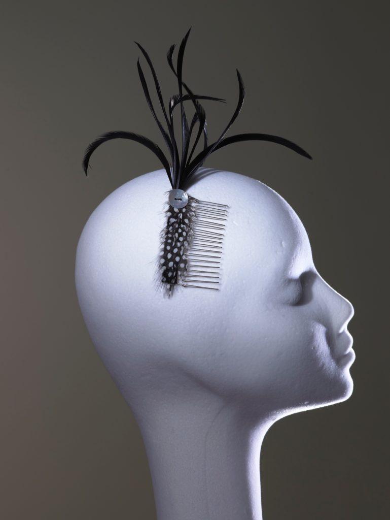 Hair comb with guinea fowl feathers