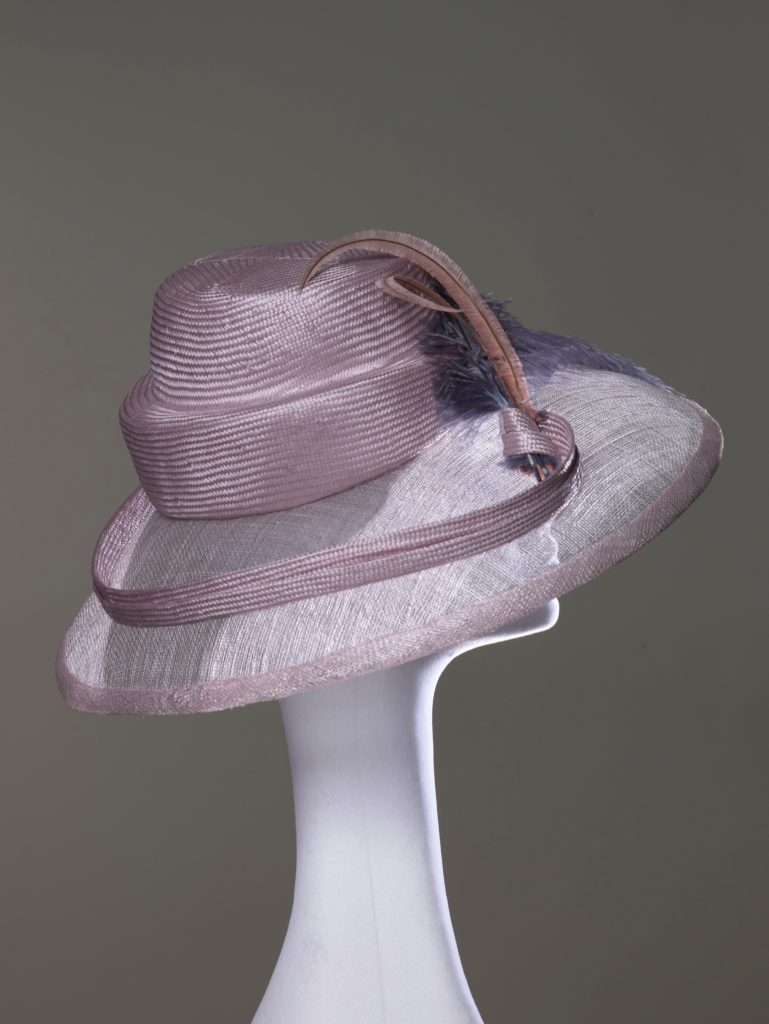 Pink parasisal straw and sinamay hat with ostrich feathers side view