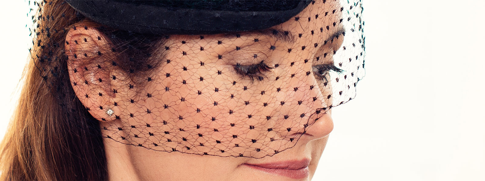 close up of face with hat and netting