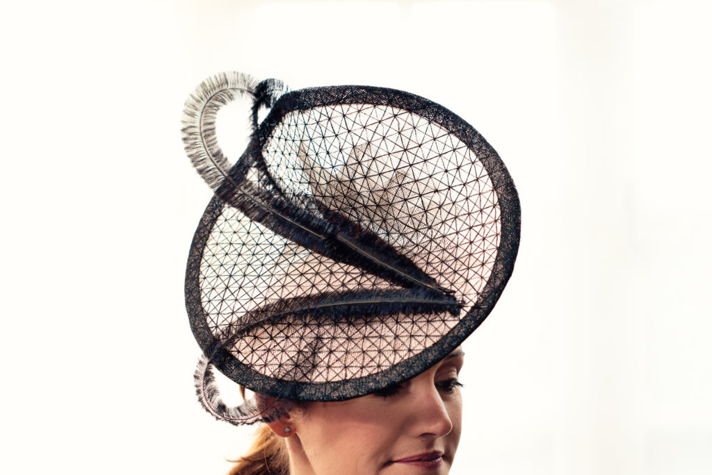 Nude and black sinamay disc fascinator with ostrich feathers