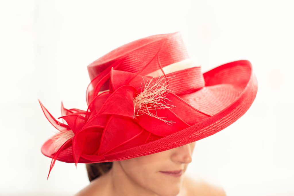 Red wide brimmed parasisal straw hat  with Lilies