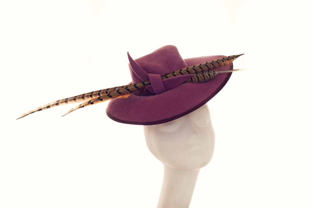 purple felt hat with pheasant feathers