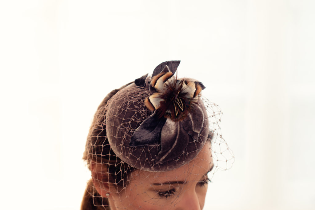 Taupe silk velvet button hat with veiling, pheasant and partridge feathers