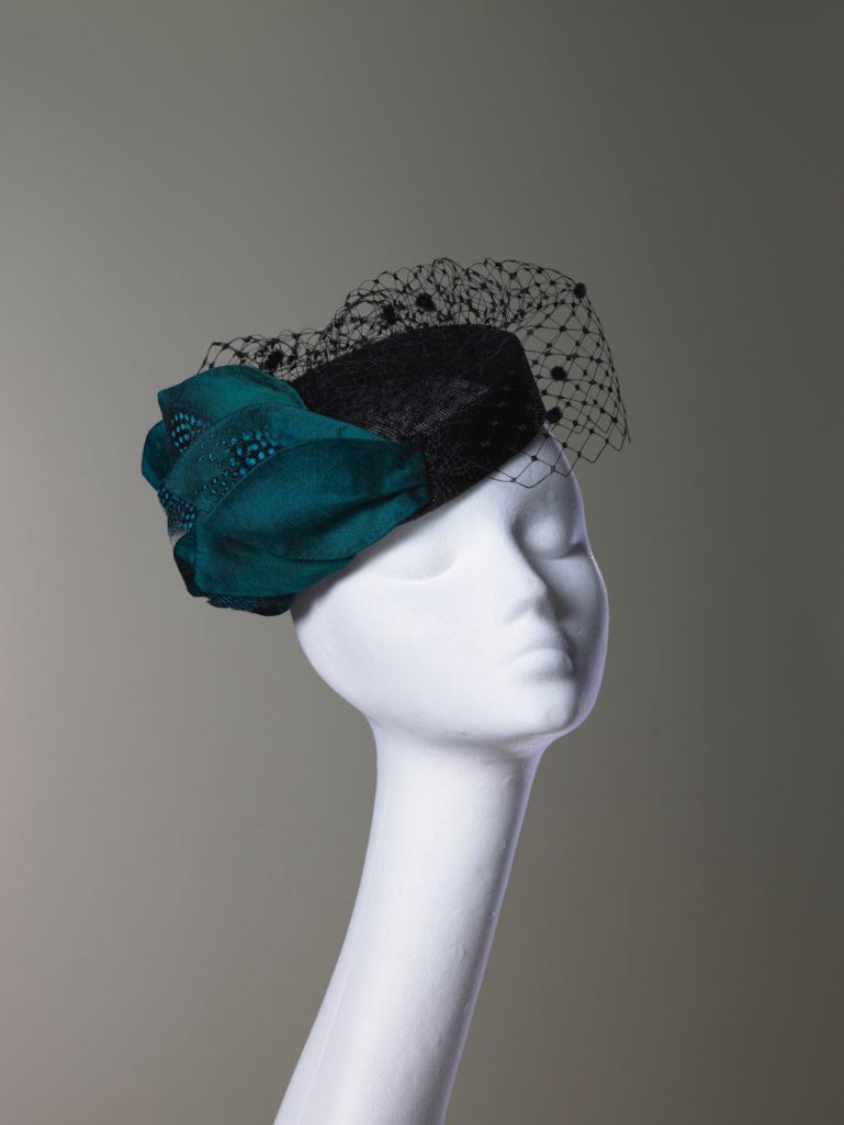 Black sinamay pillbox hat with silk leaves and veiling