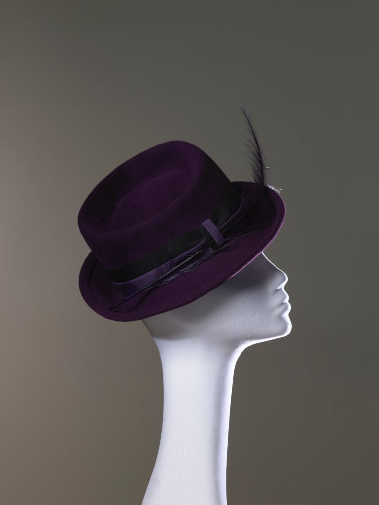 Purple felt hat with feather side view
