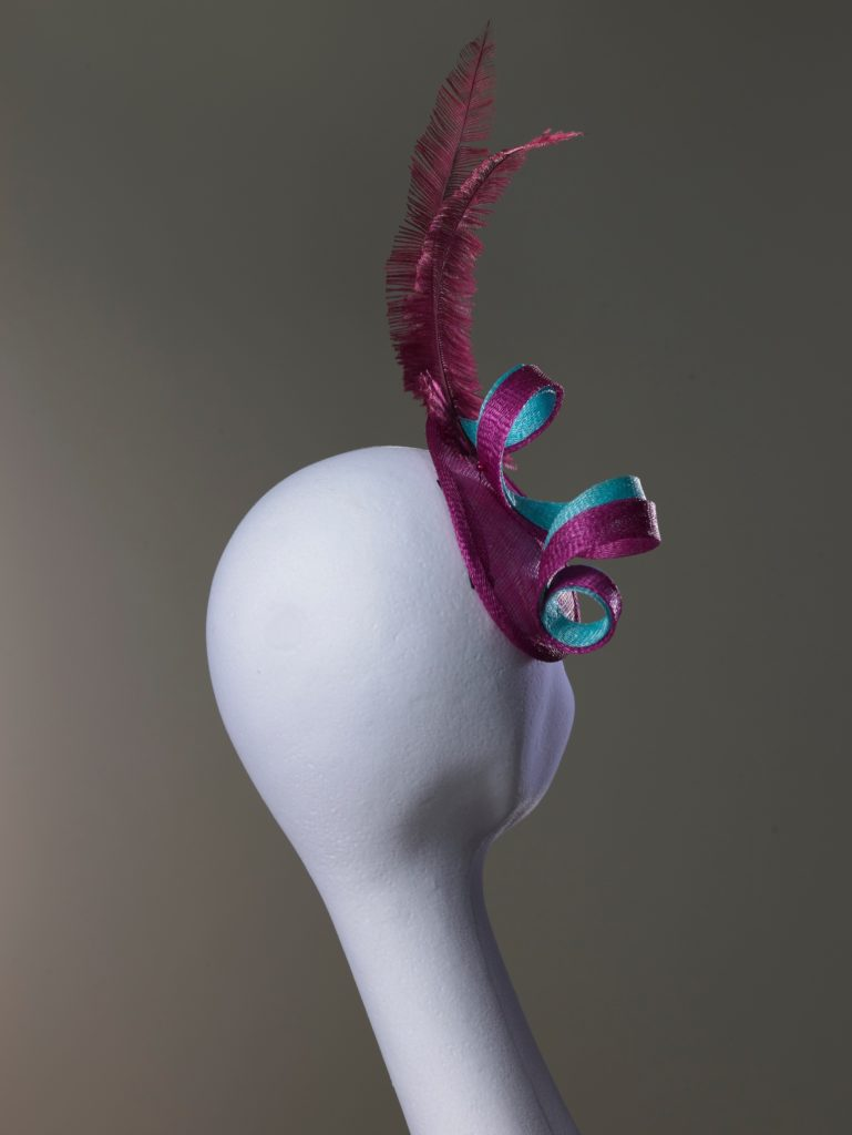 Tamsin - Pink sinamay fascinator with ostrich feathers rearview