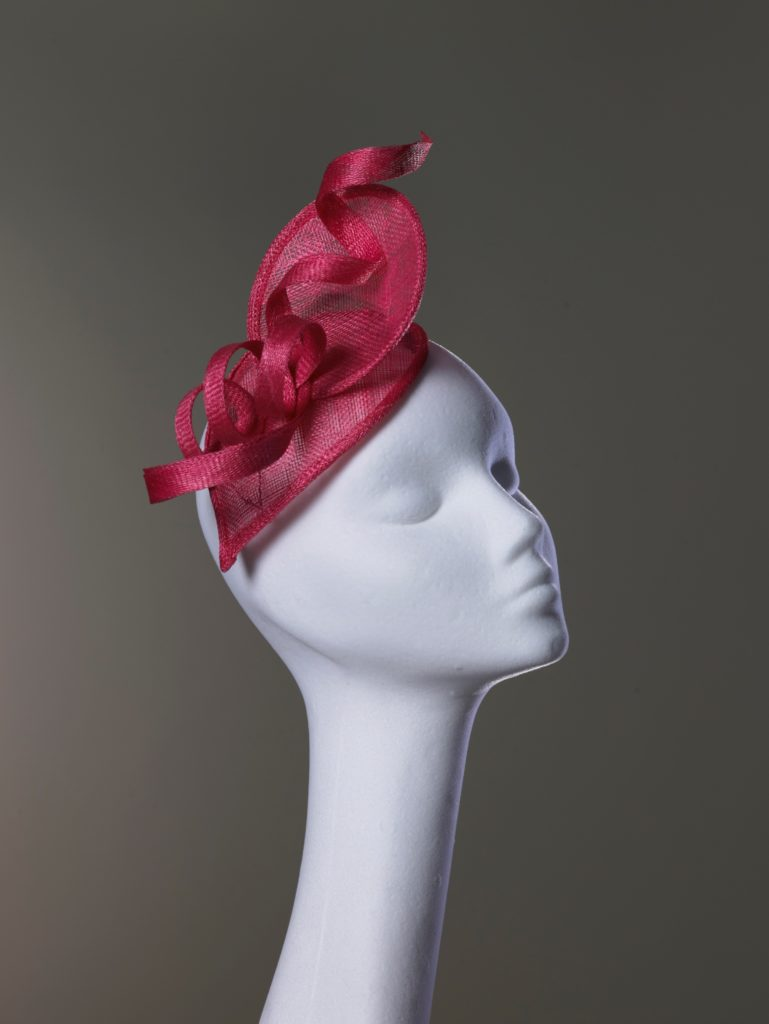Pink sinamay headpiece with curls
