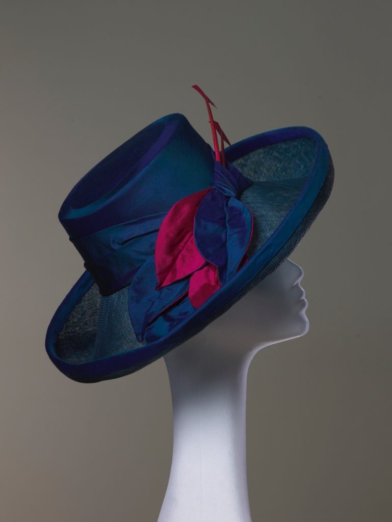 Blue silk and sinamay hat with arrowheads side view