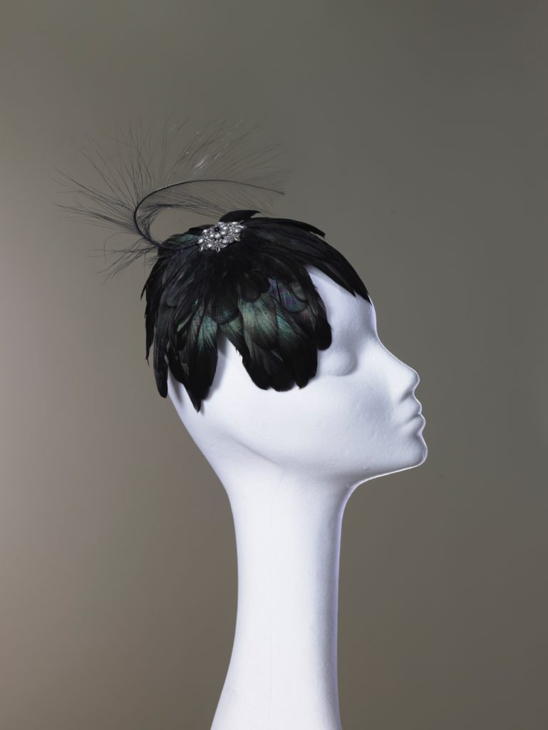 Black feather headpiece with jewel