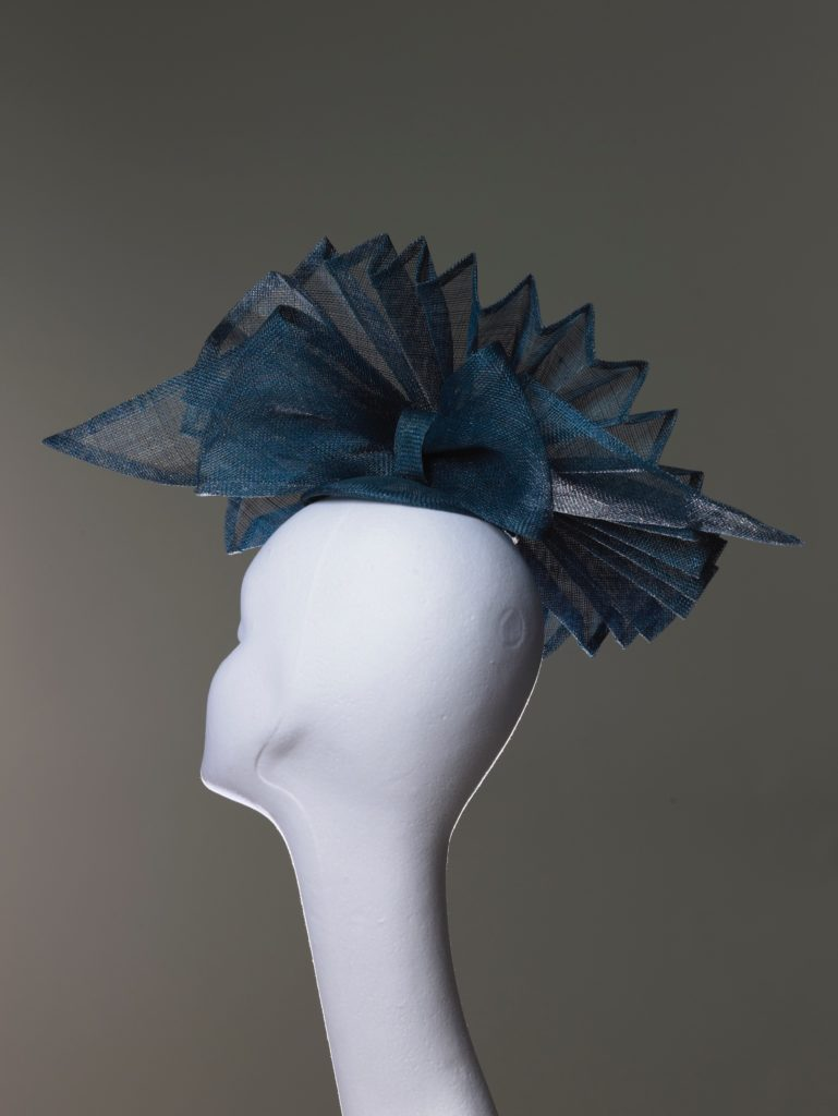 Teal pleated sinamay headpiece rear view