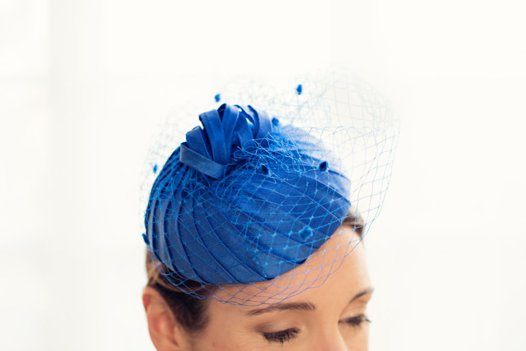 Blue pleated silk button hat with veiling