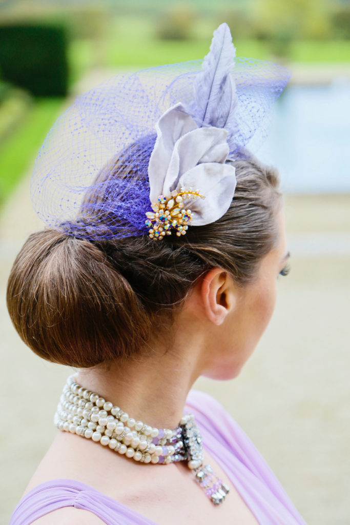 Purple silk velvet and jewel headpiece with feathers and veiling