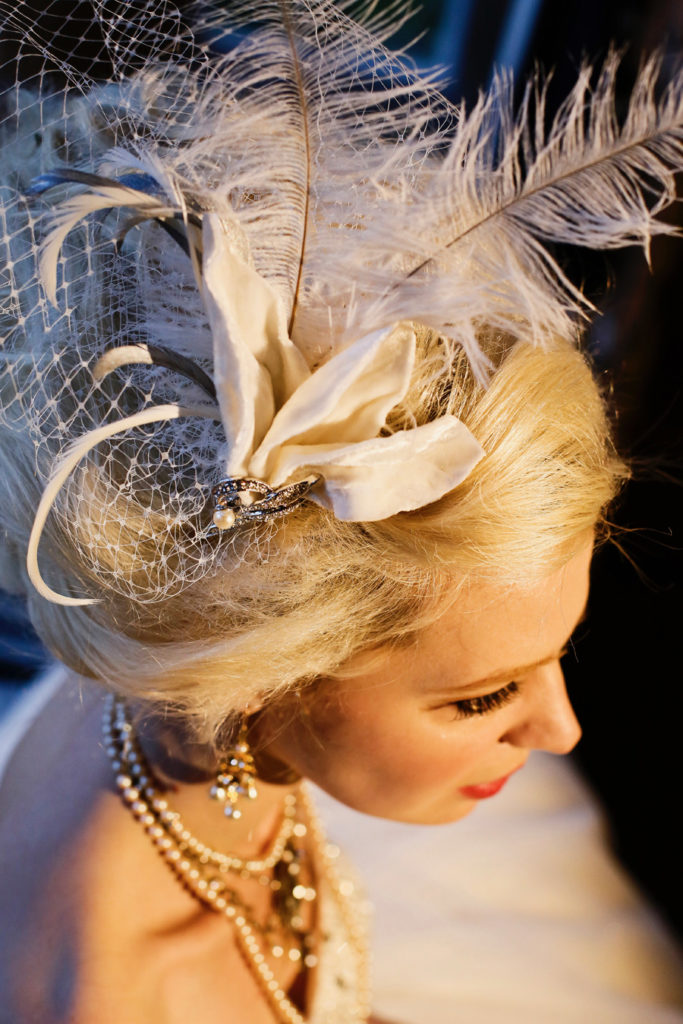 Ivory silk velvet and jewel fascinator with feathers and veiling