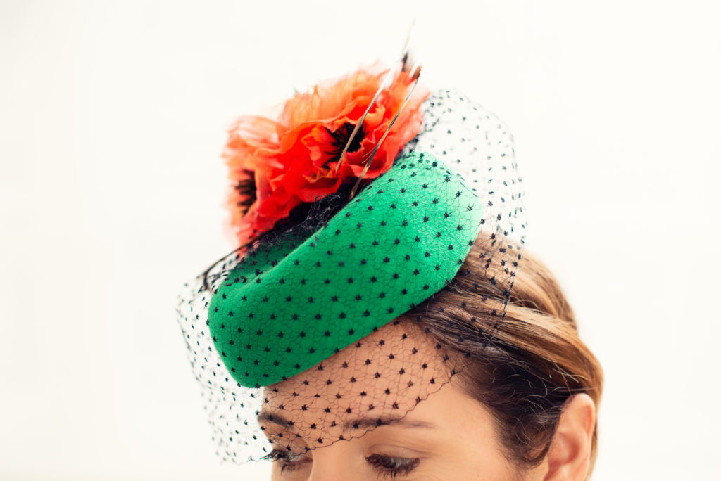 Green felt pillbox hat with orange silk poppies and pheasant feathers