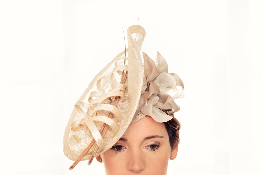 Ivory and sparkle sinamay disc fascinator with quills and silk flower