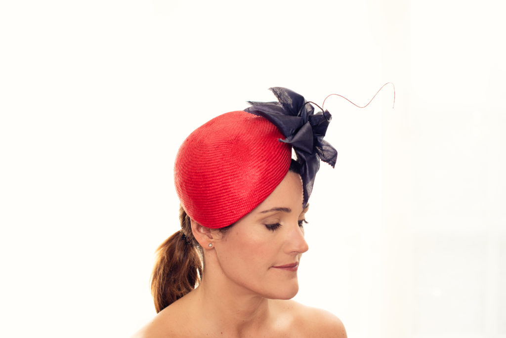 Red parasisal straw beret with silk flower and curled quill